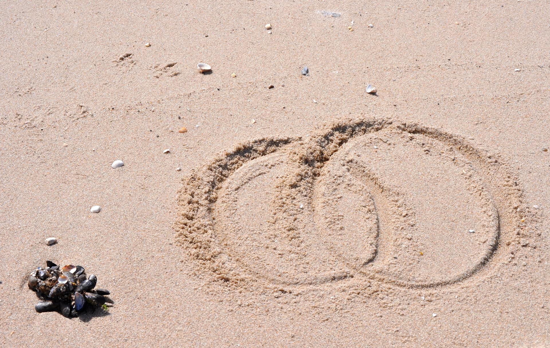 Anillos en la playa - Enlace
